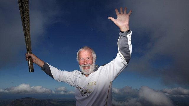 Sir Chris Bonington on the summit of Snowdon