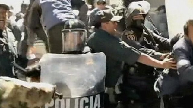 Demonstrators and police in Peru
