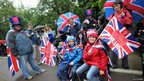 Revellers queue to enter a Jubilee Party in Battersea Park on 3 June, 2012 in London, England