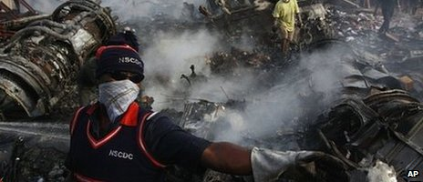 Rescue workers search for bodies at the site of a plane crash in Lagos, Nigeria, Monday, June 4, 2012.