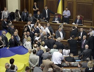 Party of the Regions MPs surround the speaker's tribune in the Ukrainian parliament, 5 June