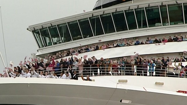 Passengers waving from ships's deck