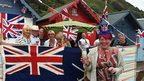 "Diamond Jubilee celebrations continued in Cromer on Tuesday with bunting flying in the wind from the main pier and revellers partied in their beach huts. ""We call it our pub on the prom,"" said Linda Farrow."