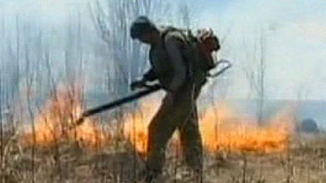 Russian fireman fighting the blaze