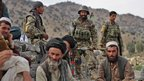 Village elders and Afghan soldiers
