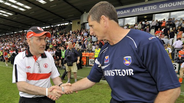 Paddy O'Rourke shakes hands with Mickey Harte at the Athletic Grounds