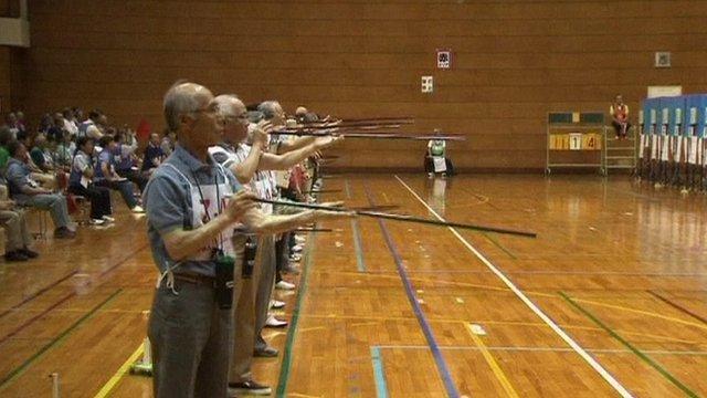 Blow dart craze grips Japan elderly