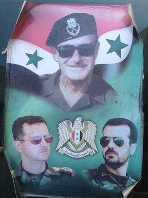 Poster showing Hafez al-Assad (centre), Bashar al-Assad (lower left) and Maher al-Assad (lower right)