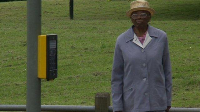 Woman at pedestrian crossing