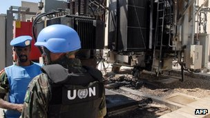 UN observers inspect a power station allegedly attacked by rebels in Qaboun, Damascus (9 June 2012)