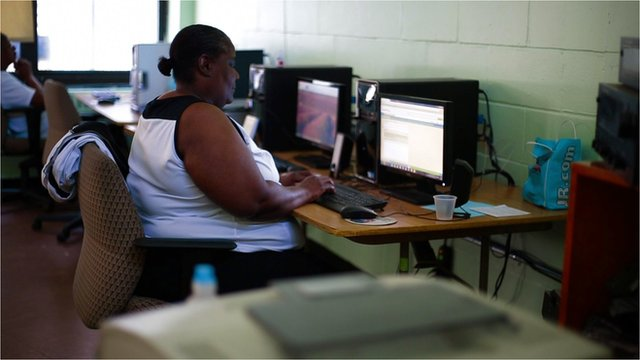 Jobseeker at a computer workstation