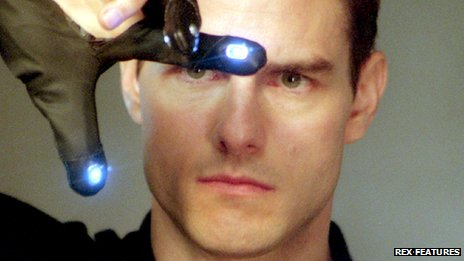 """Tom Cruise as John Anderton (wearing a """"data glove"""") in the film Minority Report"""