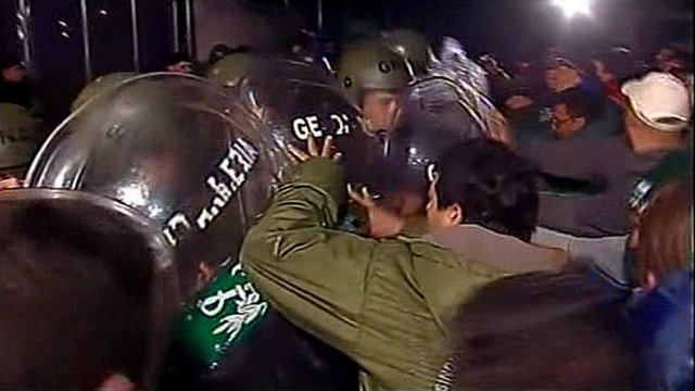 Military police confront truck drivers staging a fuel blockade