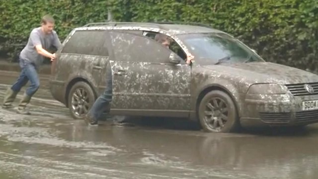 Car stranded in mud