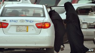 Saudi women get into a taxi outside a shopping mall in Riyadh on June 22, 2012