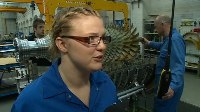 Girl working at engine plant