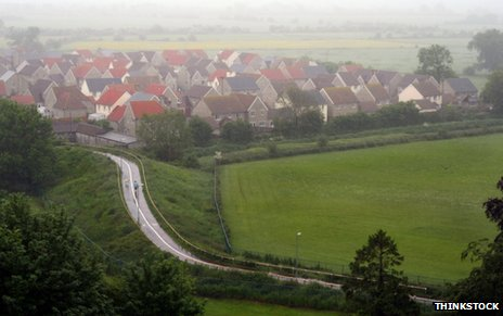 Clustered houses surrounded by fields