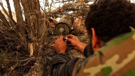 Omar, a rebel, planting an IED in Idlib, Syria (Picture by Darren Conway)