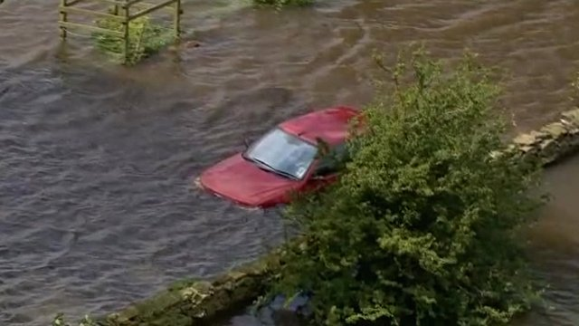 Car immersed in floodwater