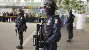 Police officers stand guard at Mexico City's main airport in the wake of the police shooting