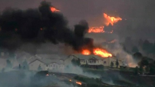 Fire threatens homes