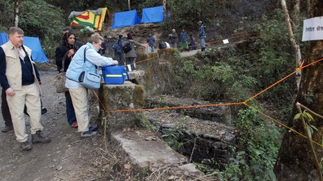 Finnish forensic experts Professors Helena Ranta (Foreground-L) and Pekka Saukko (R) prepare to carry out investigations in the Shivapuri jungle on the outskirts of Kathmandu on February 6, 2008 - where Maoist fighters killed by the army were suspected to be buried
