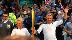 Torvill and Dean with the Olympic torch