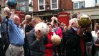 Shrovetide footballers following the torch relay through Ashbourne