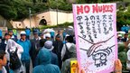 Protesters and police in Ohi, Japan. Photo: Murayama Yasufumi