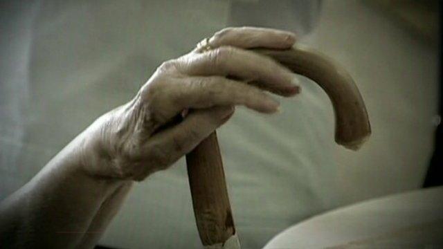Hand on walking stick handle