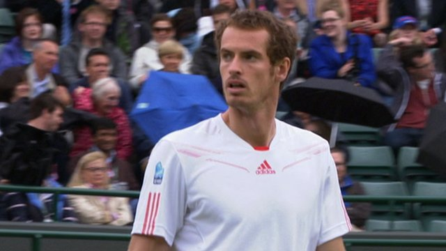 Britain's Andy Murray's fourth round game is interrupted by rain
