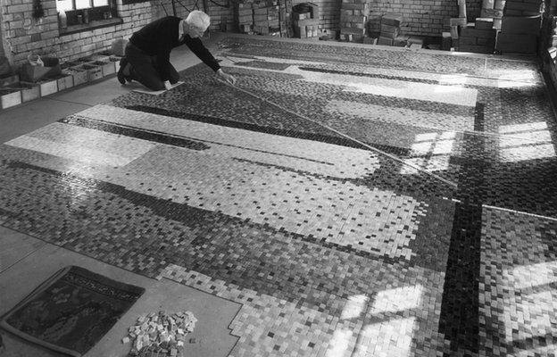 Artist John Piper at work on mosaic mural