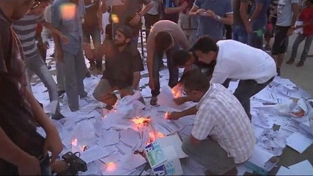 Protesters at the regional electoral authority in Benghazi