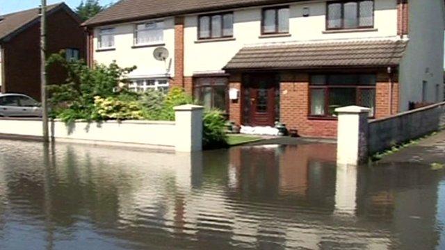 A house on a flooded street