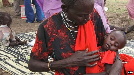 This photo taken on 15 June 2012 at the Jamam refugee camp shows Anima Hassan Omer cradling her granddaughter Khalifa at a Medecins Sans Frontieres (MSF) field hospital in South Sudan's Upper Nile state