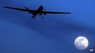 A US RQ-1 Predator drone or UAV (Unmanned aerial vehicle) flies over the moon above Kandahar Air Field, southern Afghanistan