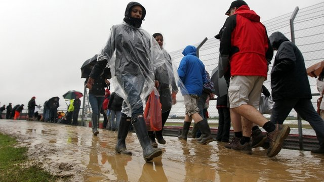 Fans at a very muddy Silverstone