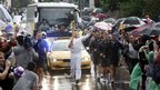 Jamie Oliver carries the Olympic Flame on the Torch Relay journey between Newport and Saffron Walden.