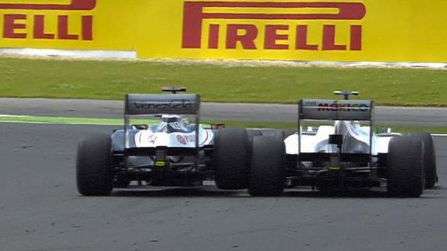 Williams' Pastor Maldonado (l) hits Sauber's Sergio Perez