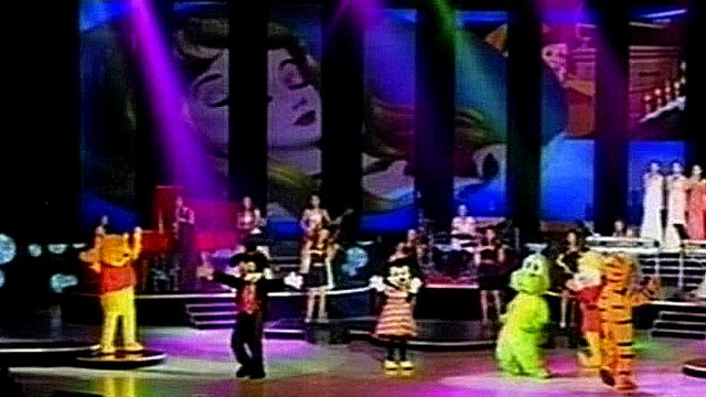 Disney characters performing on stage