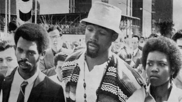 John Carlos (centre) leaving Mexico 1968 Olympic Village