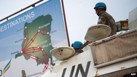 United Nations peacekeepers stand deployed with an armoured personnel carrier in the eastern city of Goma in the Democratic Republic of the Congo on 10 July 2012