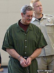 Allen Stanford in handcuffs