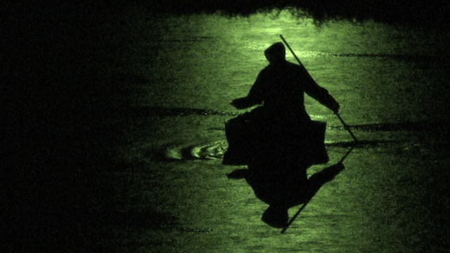 Coracle fishing by night