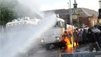 Water canon and PSNI officers on fire