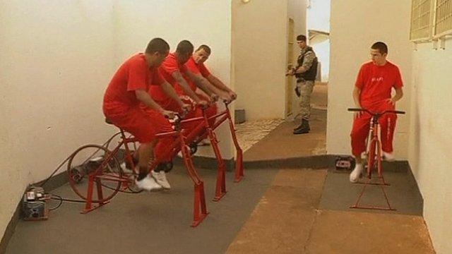 Brazil prisoners pedalling on the exercise bikes