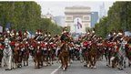 The Republican Guard ride down the Champs Elysees during the Bastille Day parade, 14 July 2012