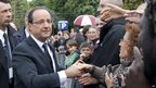 President Francois Hollande shakes hands after the Bastille Day military parade on the Champs Elysees in Paris, 14 July 2012.