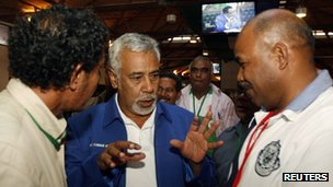 East Timor Prime Minister Xanana Gusmao (C) party officials after a news conference in Dili. 15 July