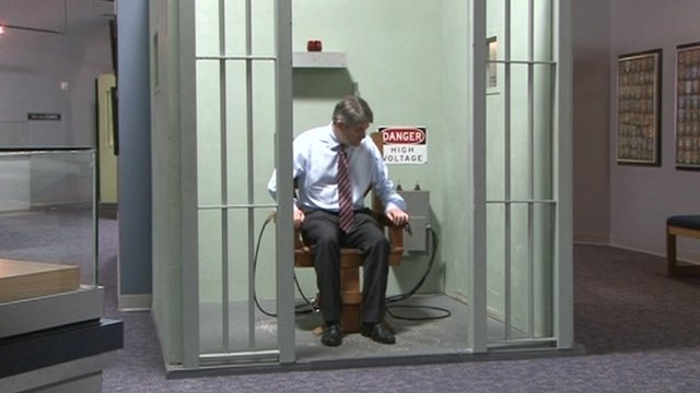 Philip Davies MP tries an electric chair